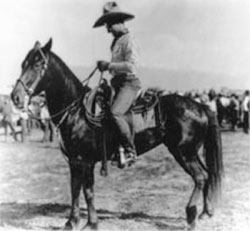 historic photo of man on a horse wearing a hat