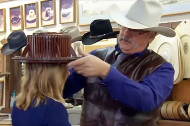 320dfb28 Ritch Rand fitting someone for a new hat.